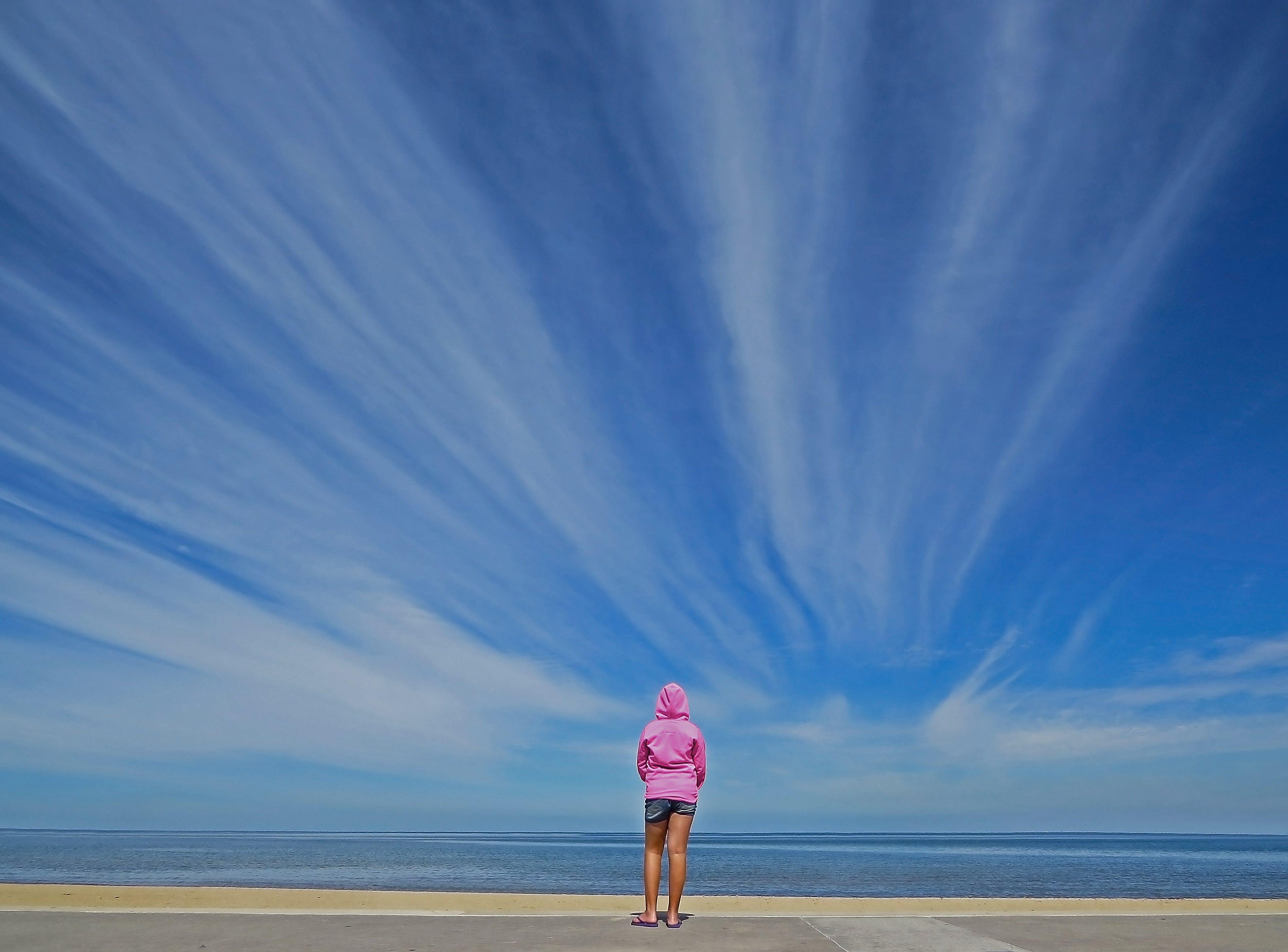 Woman Standing in Front of Seashore