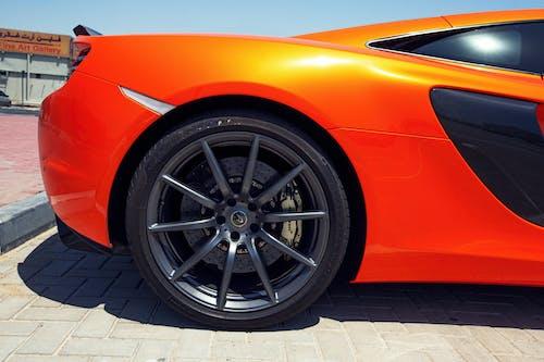 Orange Car on Gray Brick Floor