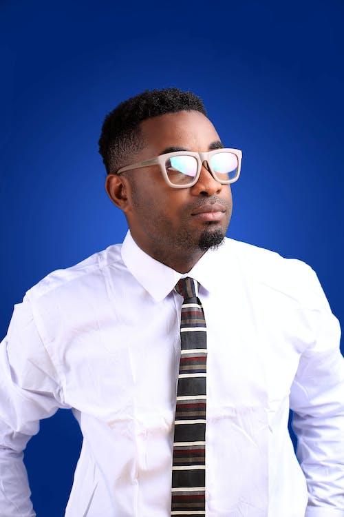 Confident black businessman in transparent eyeglasses