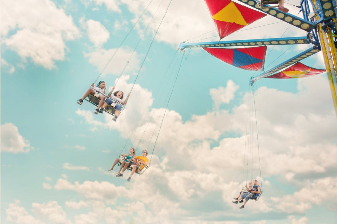 Six Persons Riding Amusement Ride