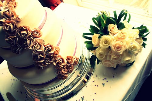 Bouquet of White Rose Beside Cake
