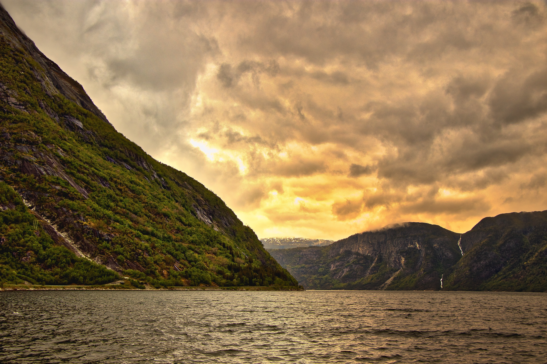 Ocean Near Mountain Ranges During Sunset 183 Free Stock Photo