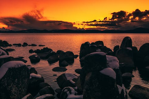 Rocks on Sea during Sunset