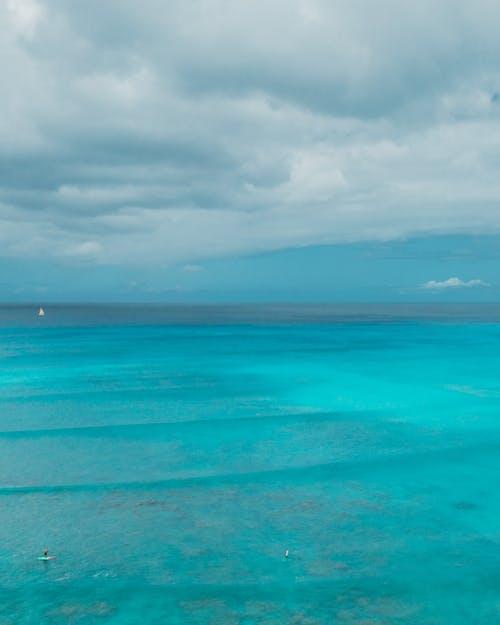 Blue Sea Under White Clouds