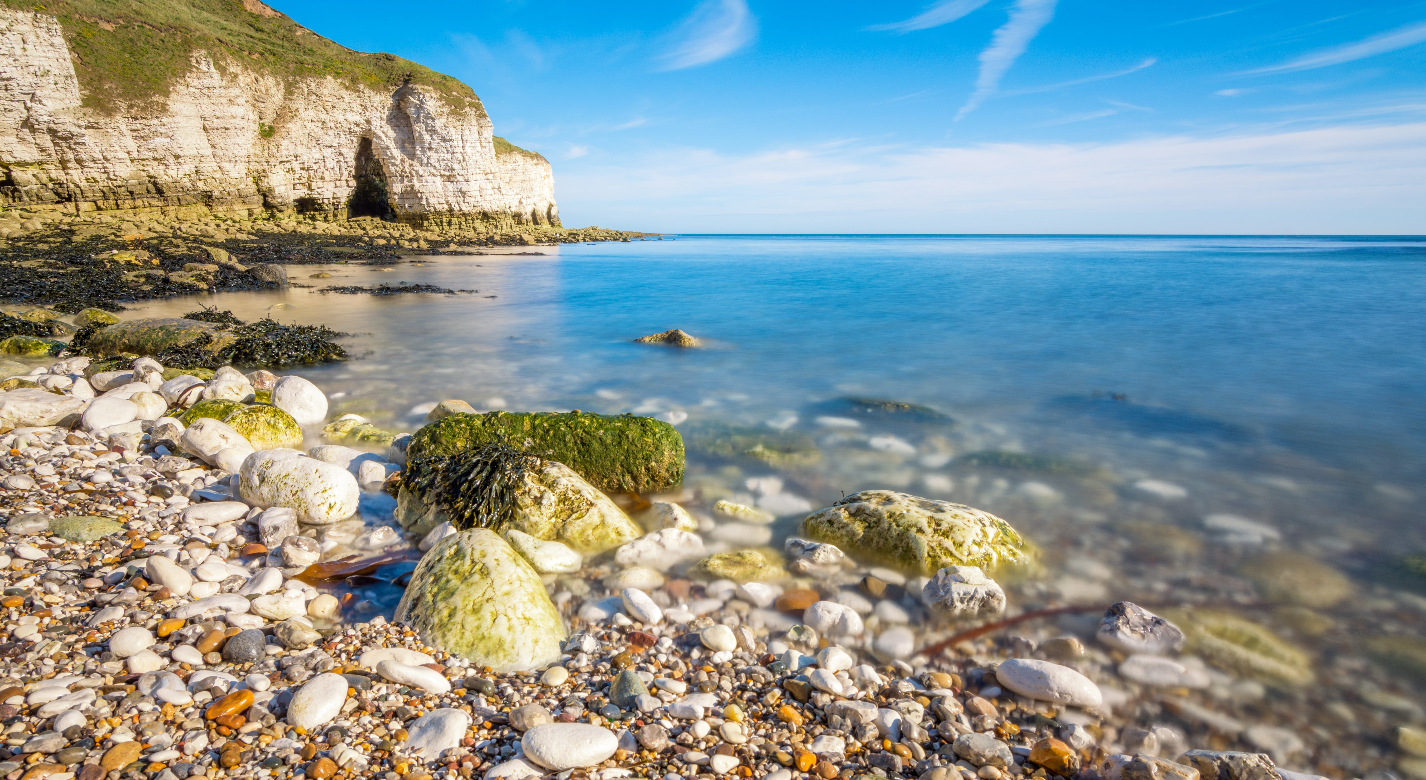 Landscape Photography of Cliffs and Body of Water