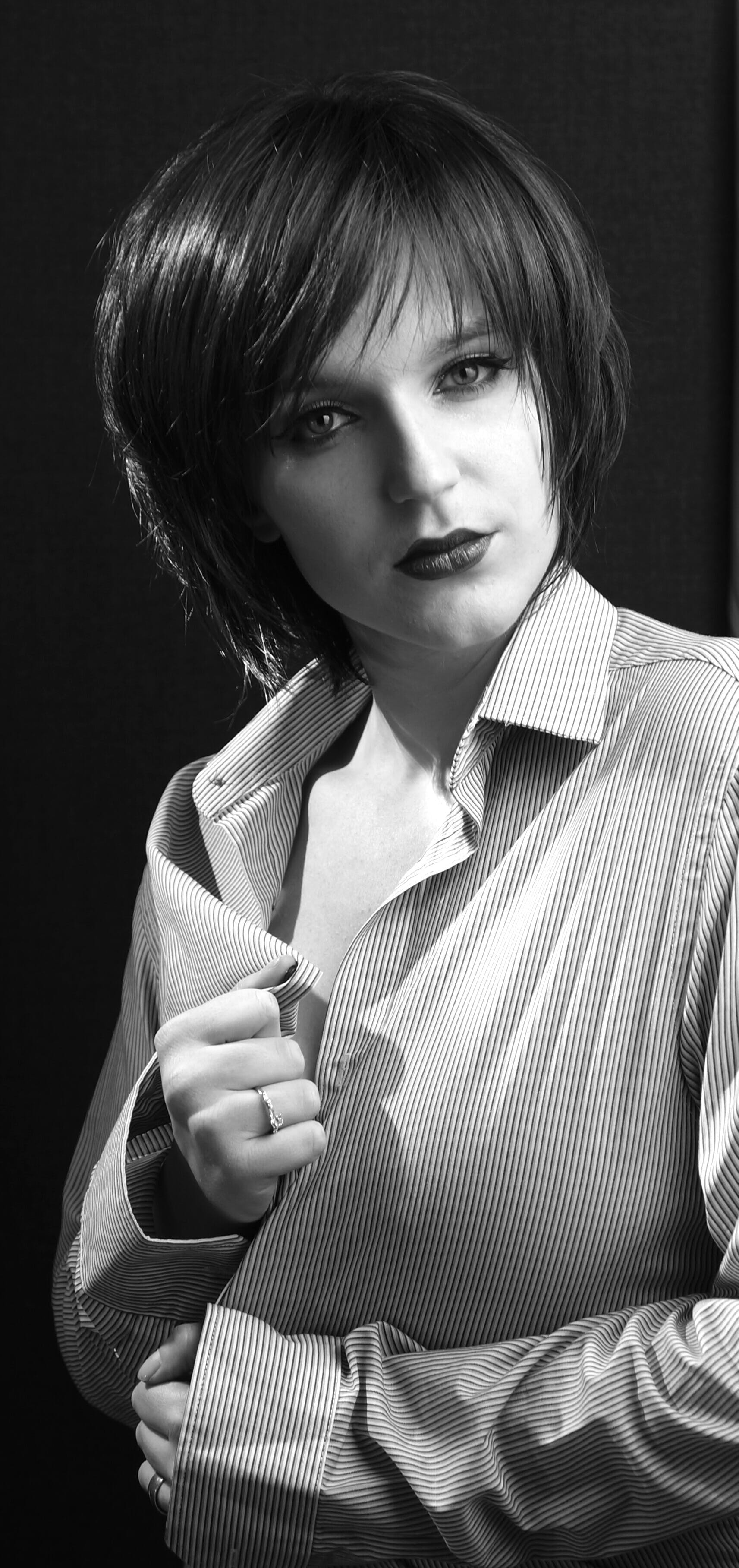 Grayscale Photo of Woman Wearing Coat