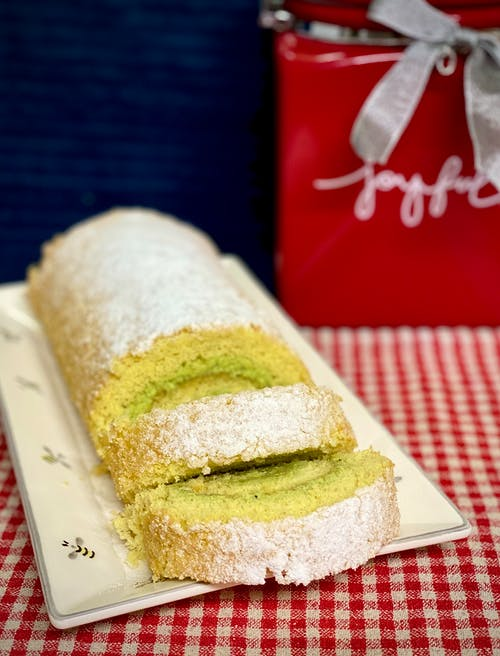 From above of bright yummy baked roll with sweet filling and icing sugar on top