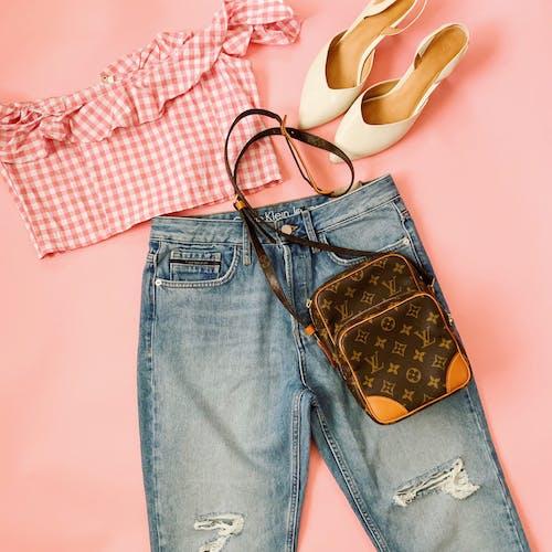 Blue Denim Jeans Beside Brown and White Flip Flops