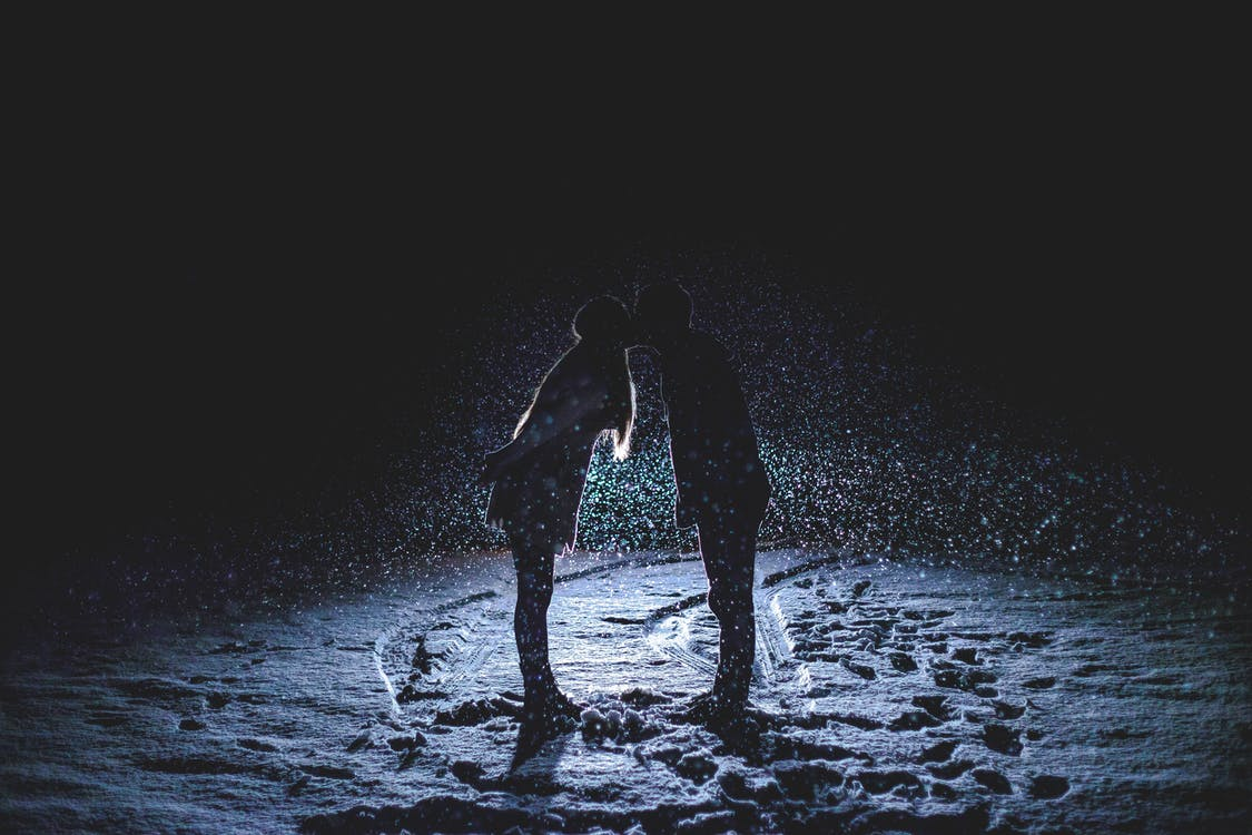 Couple Kissing on Snowfield at Night