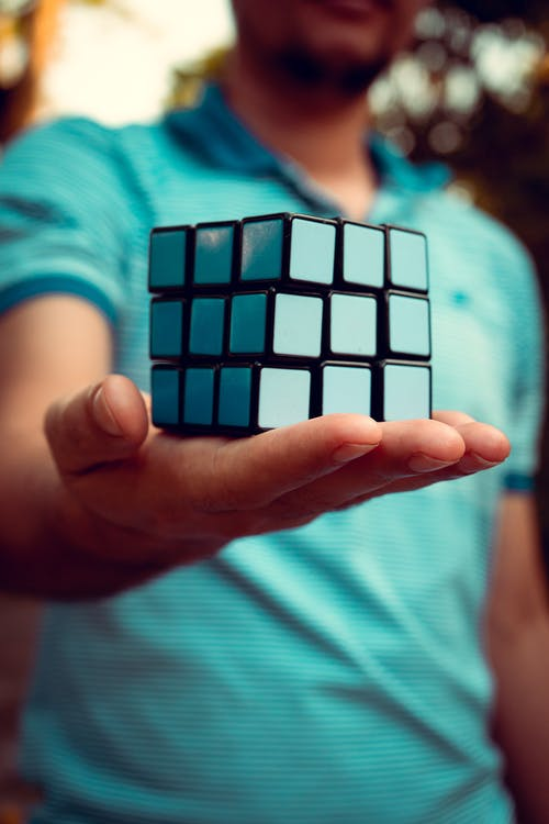 A Person Holding a Rubik's Cube