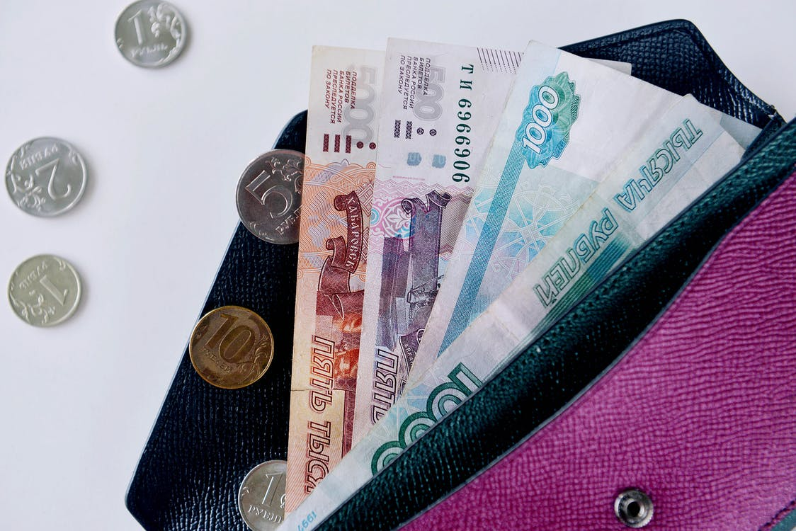 Rubles in wallet on white table. Making money