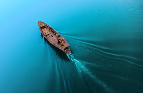 Boat floating on calm blue seawater