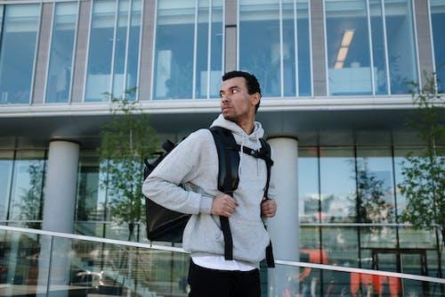 Man in Gray Blazer Standing Near Glass Building