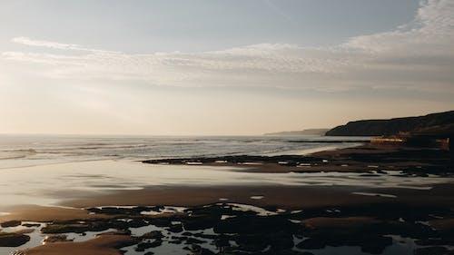 Scenic hilly seacoast near calm sea