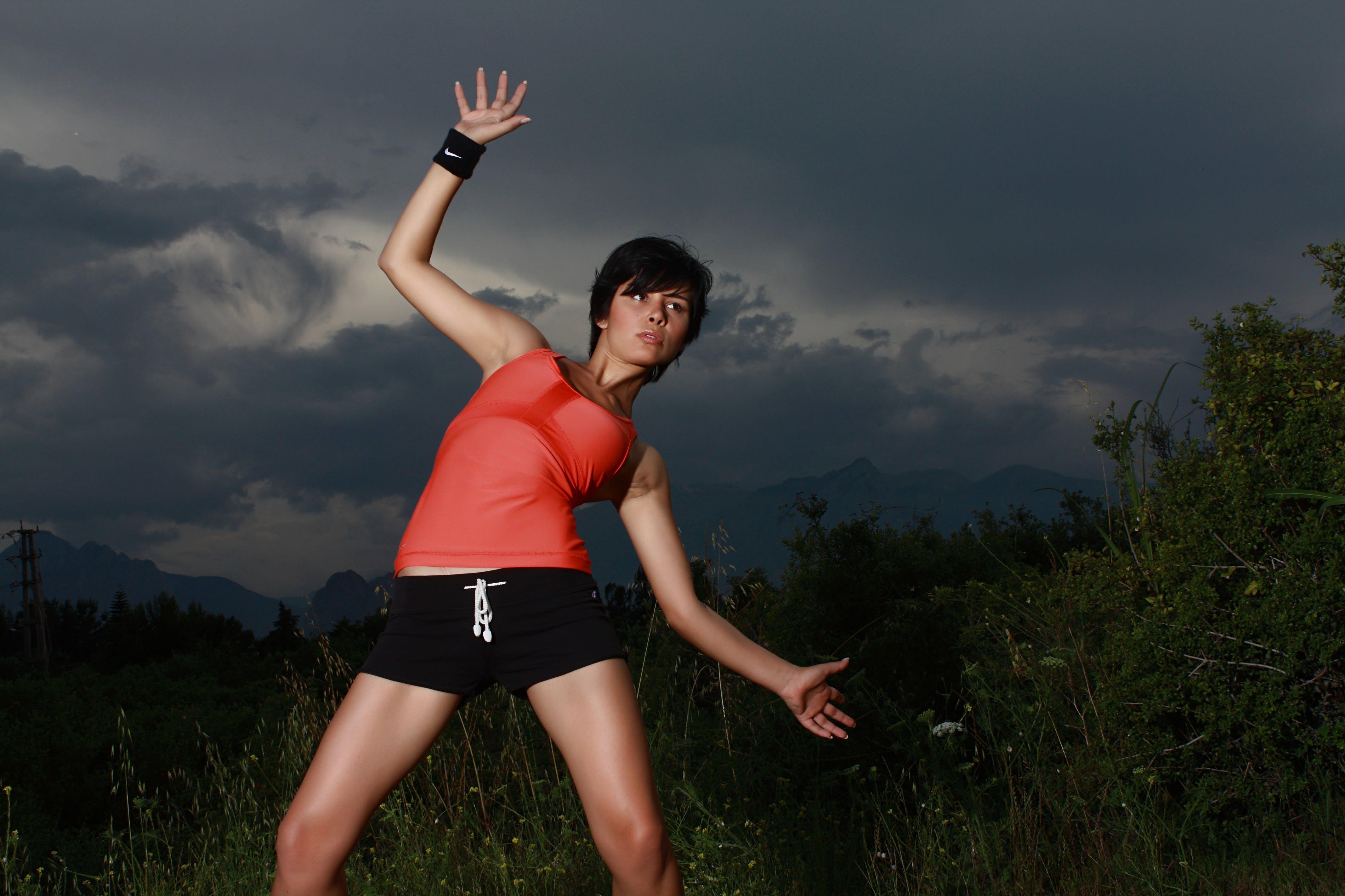 Woman Rise Hand Beside Grass Field