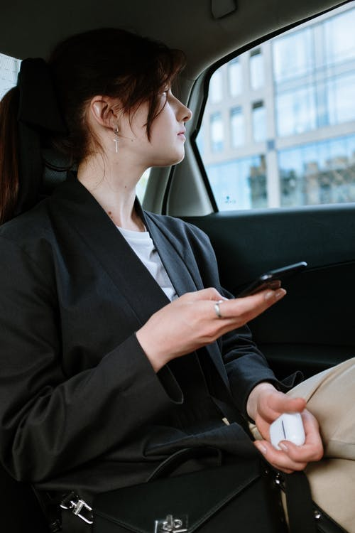 Woman in Black Blazer Sitting on Car Seat