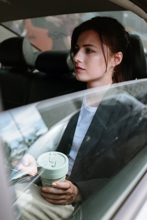 Woman in White Shirt Inside Car