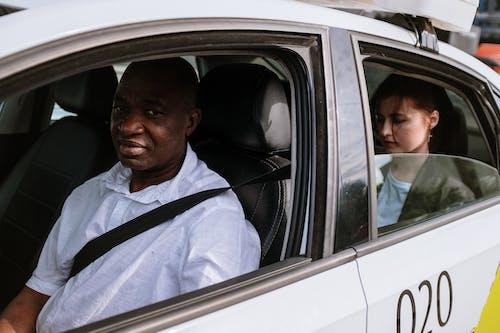 Man in White Dress Shirt Sitting Inside Car