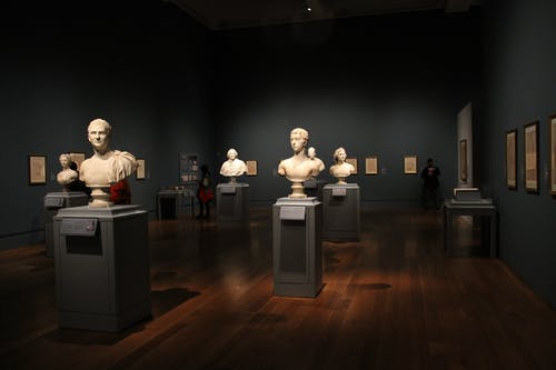 Assorted Busts on Gray Stand
