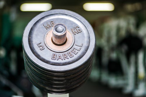 Weights on barbell in modern gym