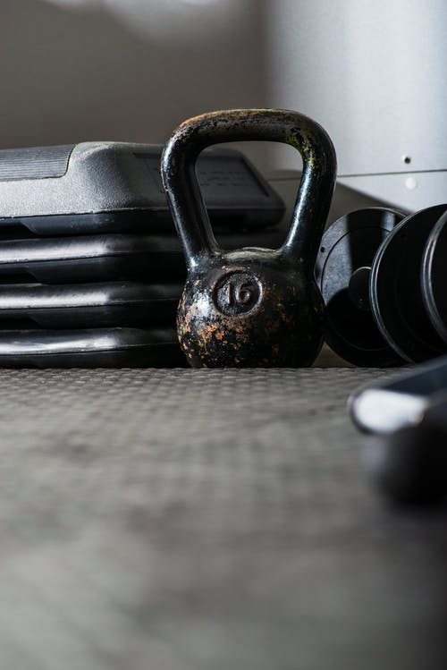 Kettle bell and dumbbells on floor in gym