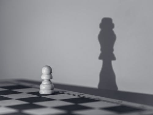 White Chess Piece on White Chess Board