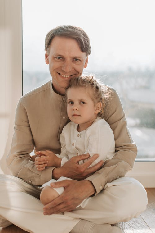 Father Sitting with his Daughter