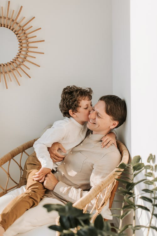 Father Getting a Kiss on the Cheek from his Son