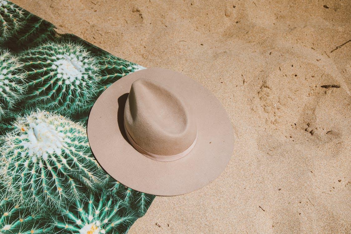 Brown Cowboy Hat on Sand