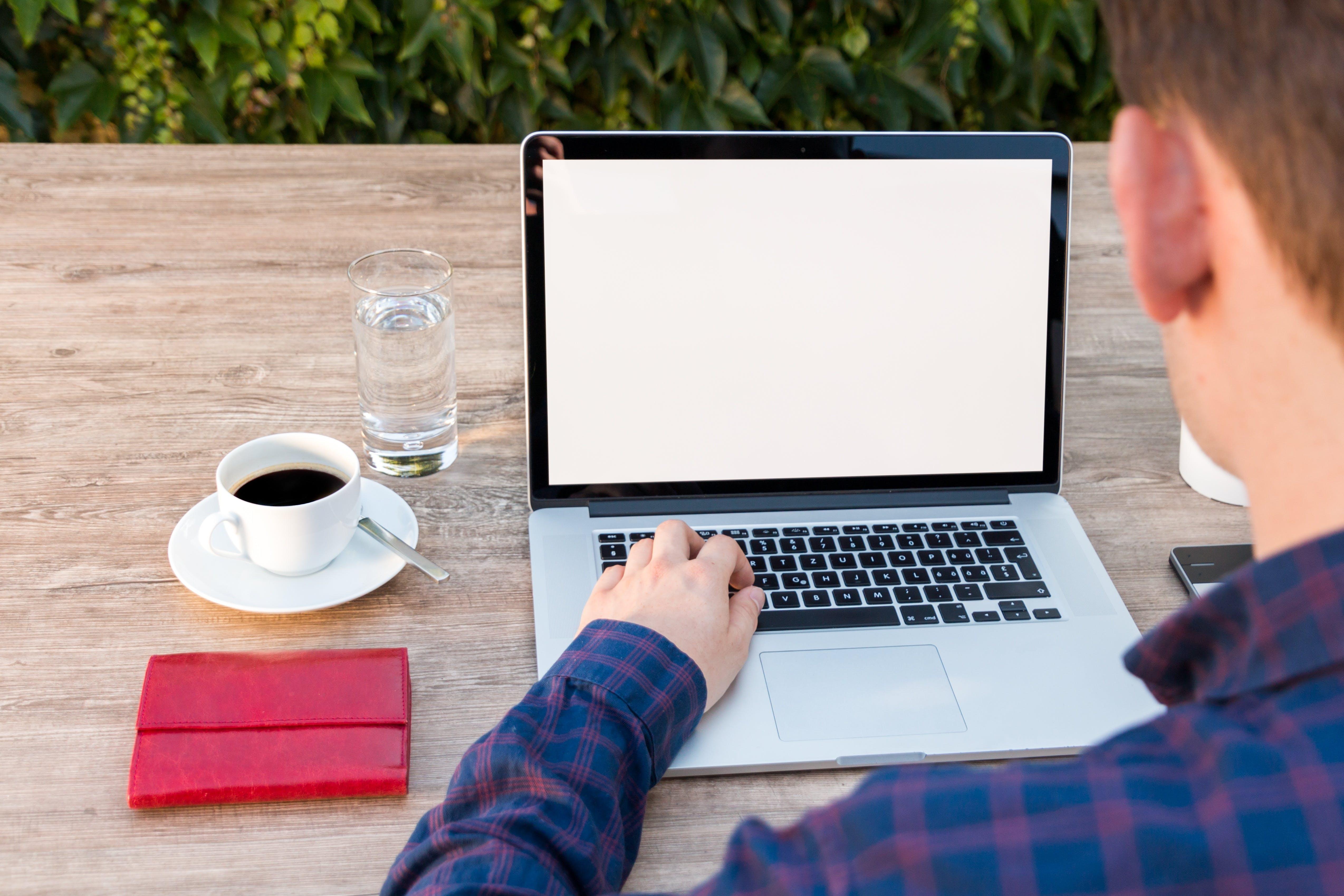 Man Sitting in Front of Macbook