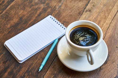 Foto d'estoc gratuïta de bloc de notes, boli, cafè, cafè exprés