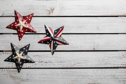 Star shaped souvenirs with American flag pattern on lumber table