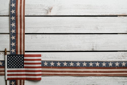 Wooden board with United States flag decorations