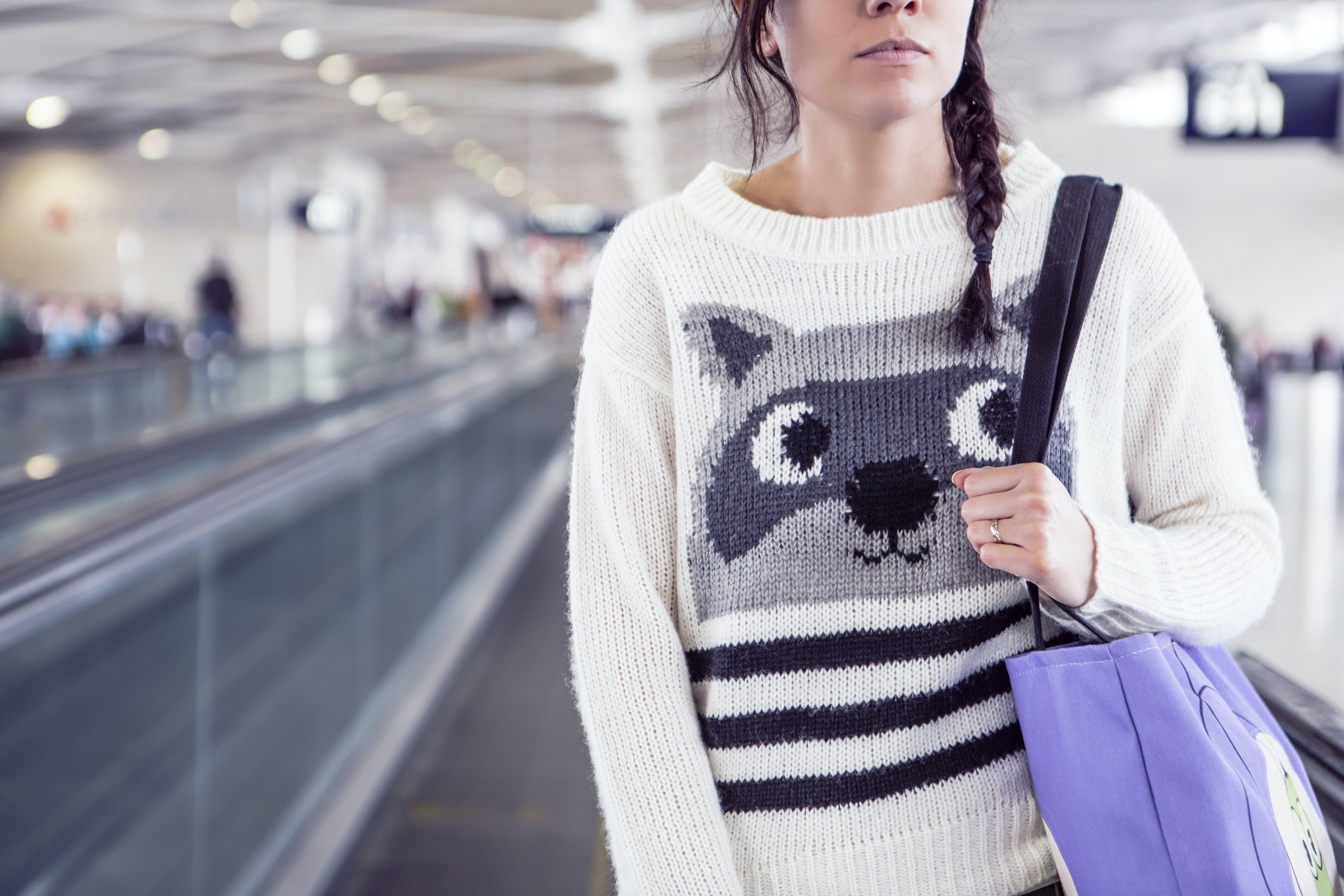 Woman Carrying Purple Shoulder Bag