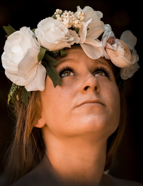 Dreamy woman with flower wreath on head