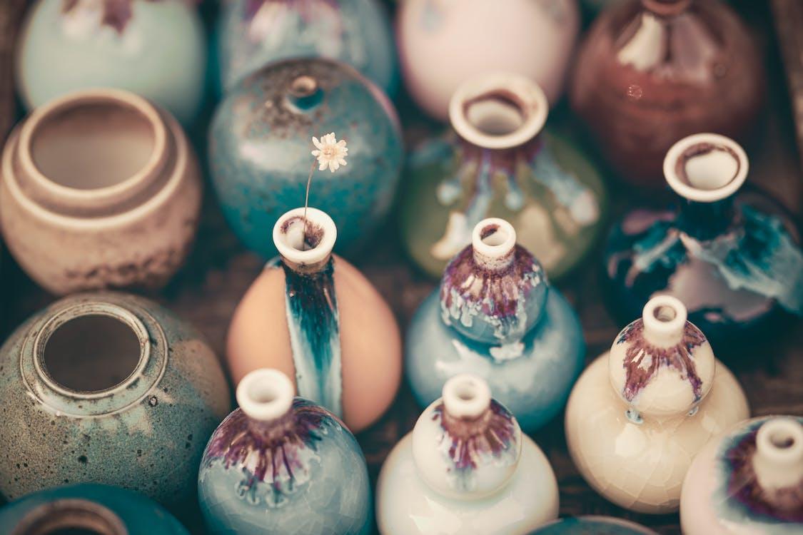 White Ceramic Vase on Blue Glass Table