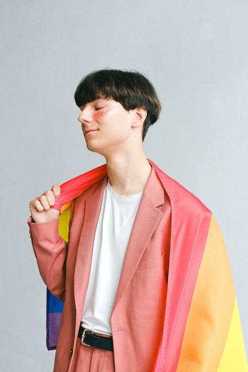 Young Man Holding a Gay Pride Flag