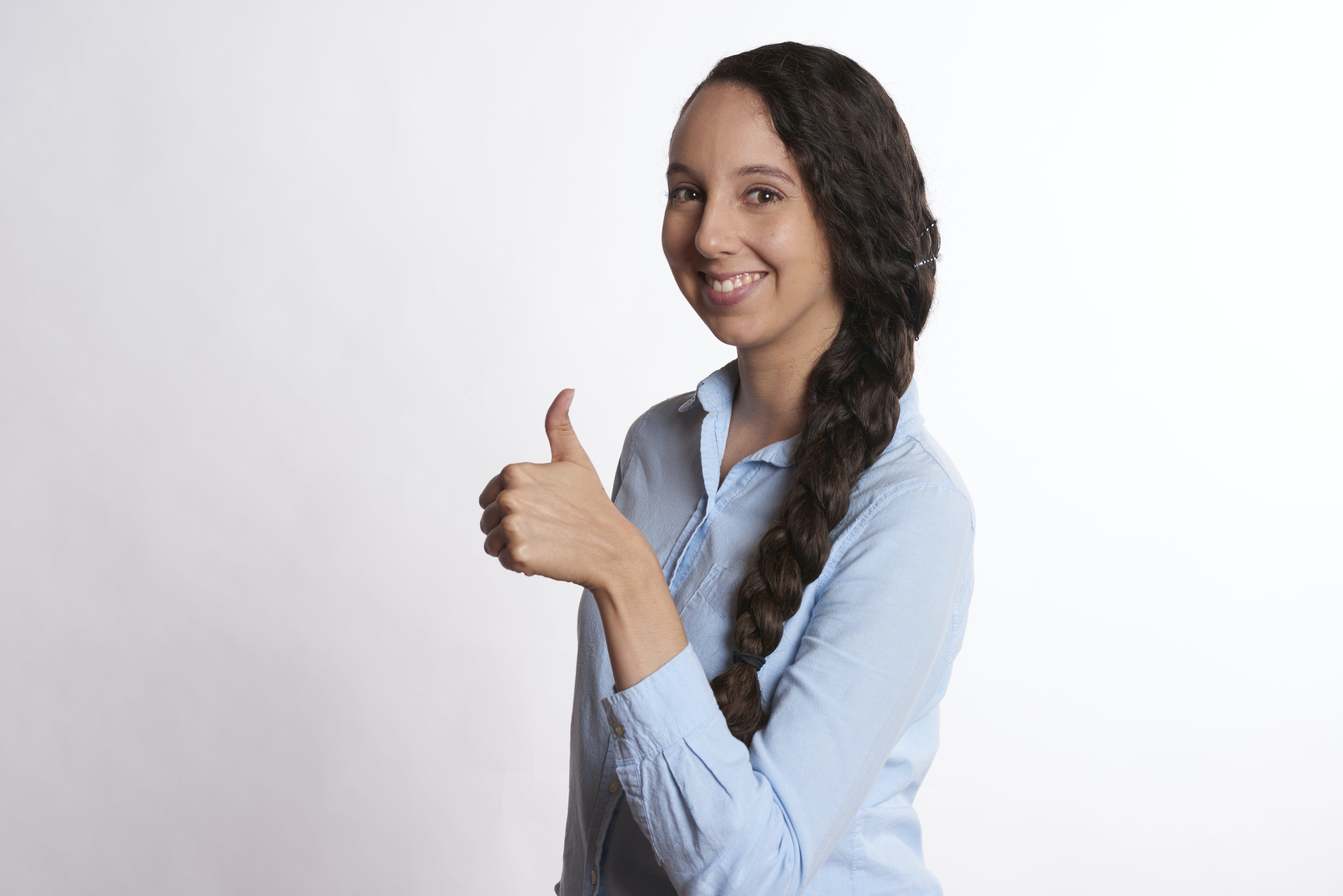 Girl Making Alright Gesture