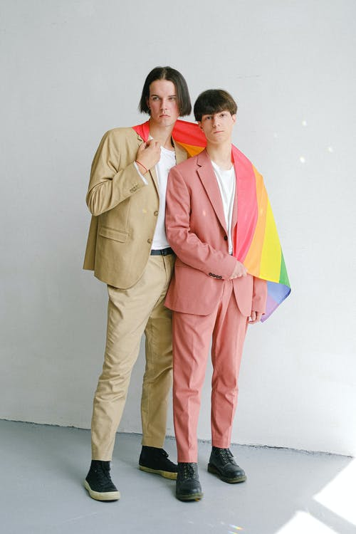 Two Men Holding a Gay Pride Flag