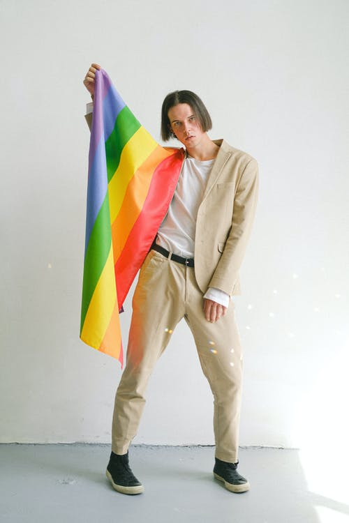 Man Holding a Gay Pride Flag