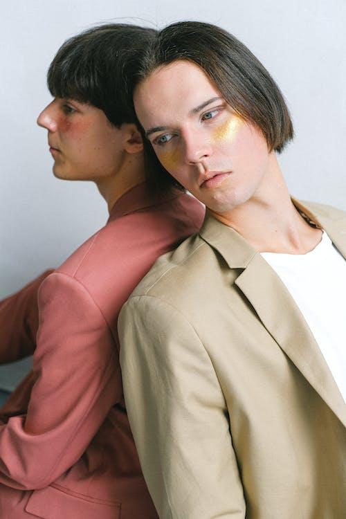 Man in Brown Suit Jacket Beside Woman in Pink Long Sleeve Shirt