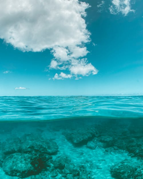 Blue Ocean Under Blue Sky and White Clouds