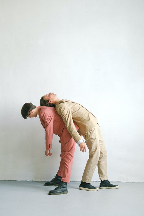 Man in Brown Dress Shirt and Brown Pants