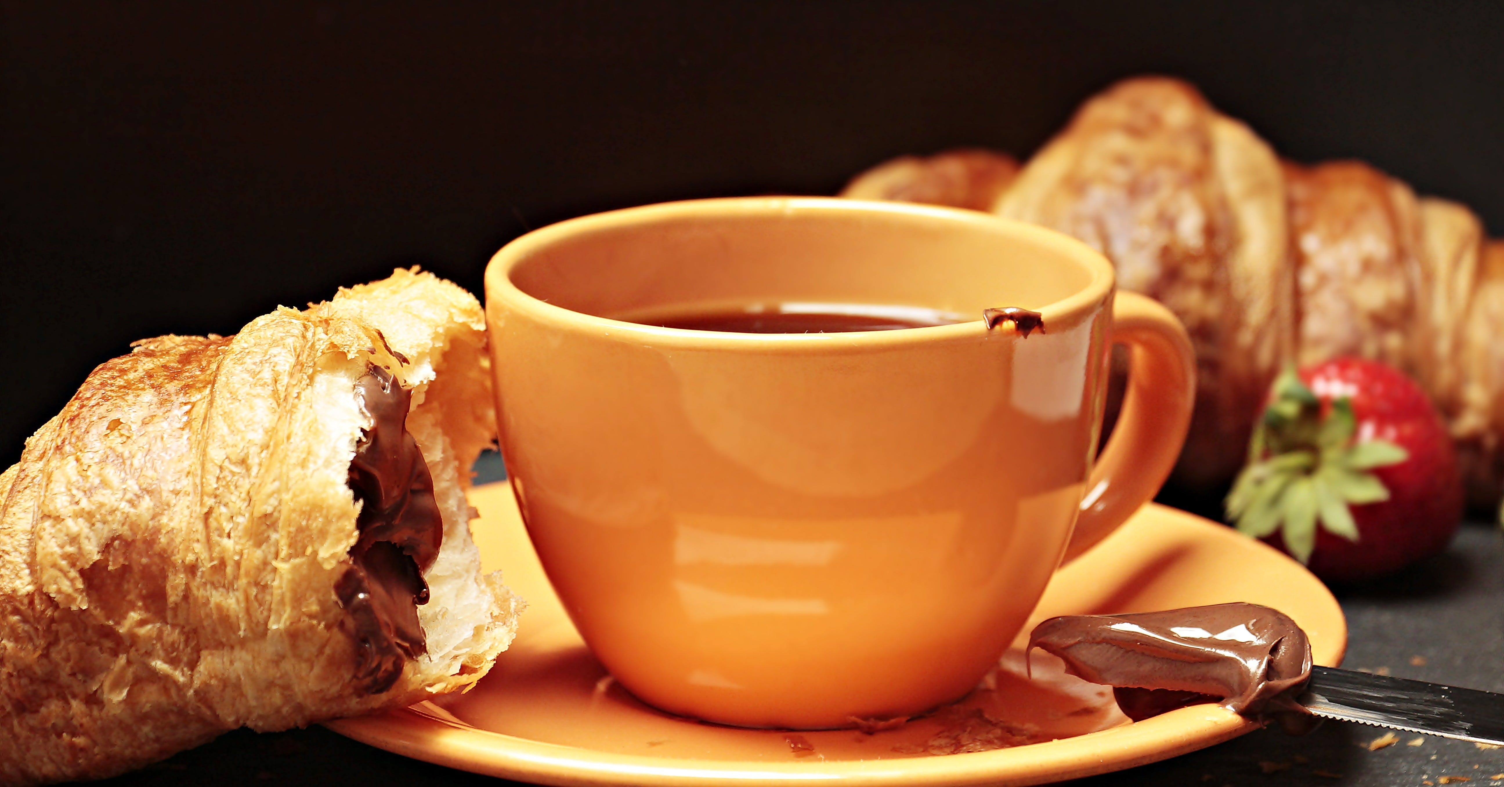 Filled Coffee Cup Beside Bread