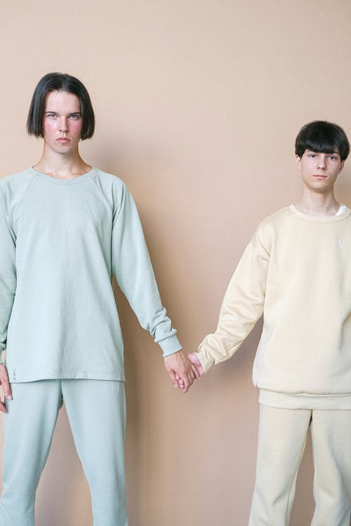 Men in Pajamas Holding Hands