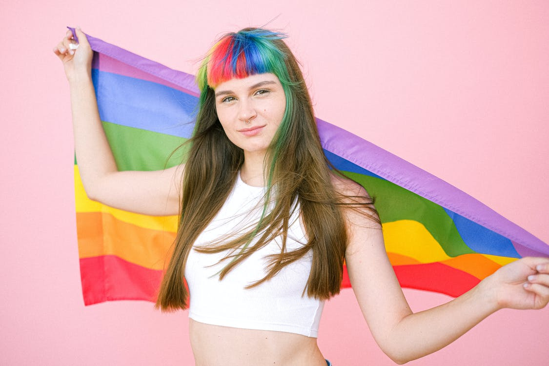 Woman Holding a Gay Pride Flag