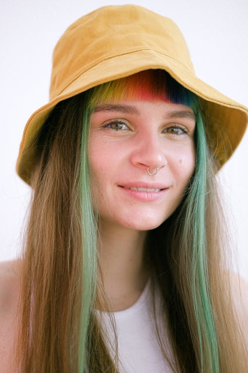 Woman in Brown Hat Smiling