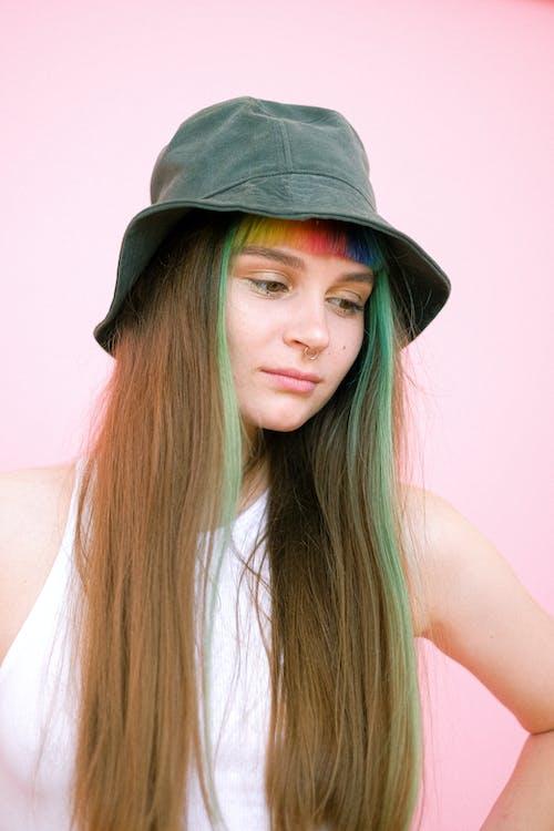 Woman in White Tank Top Wearing Gray Fedora Hat