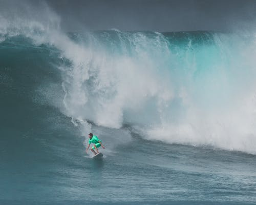 Person Surfing on Ocean Waves
