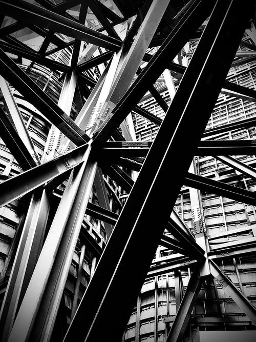 Grayscale Photo of Metal Frame